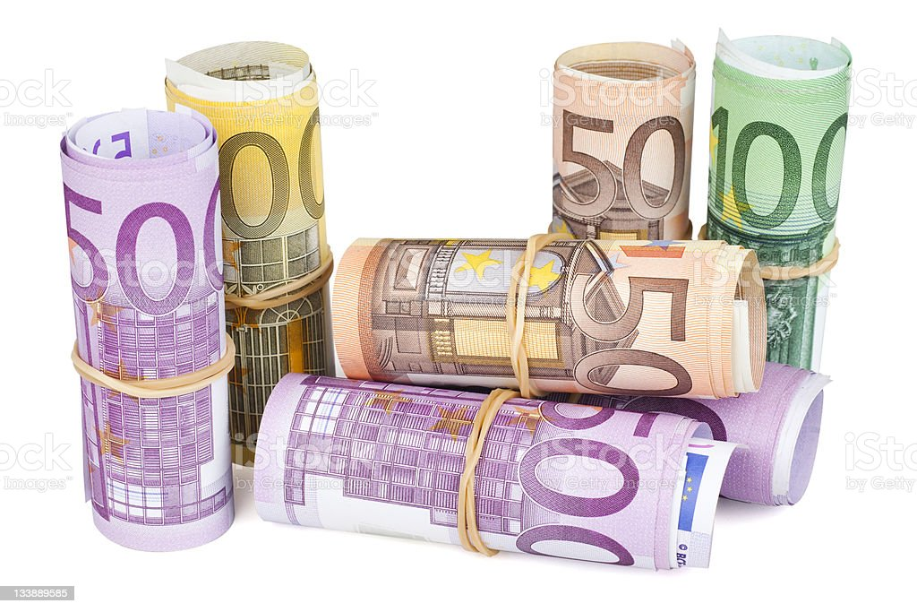 Rolled up Euro banknotes on white background stock photo