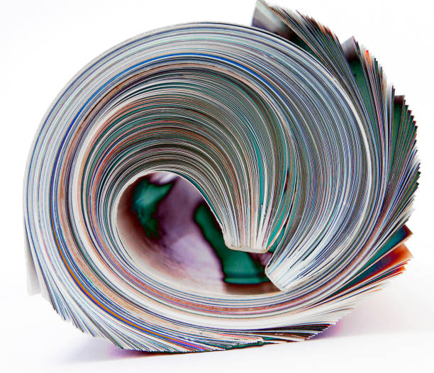 rolled up magazine  isolated on white macro i rolled up magazine  isolated on white macro image editorial stock pictures, royalty-free photos & images