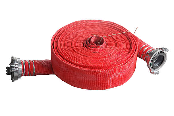 rolled up red fire hose  extension soft pipe on white Rolled into a roll, red fire hose with aluminum connective couplings, Isolated on white background. coupling device stock pictures, royalty-free photos & images