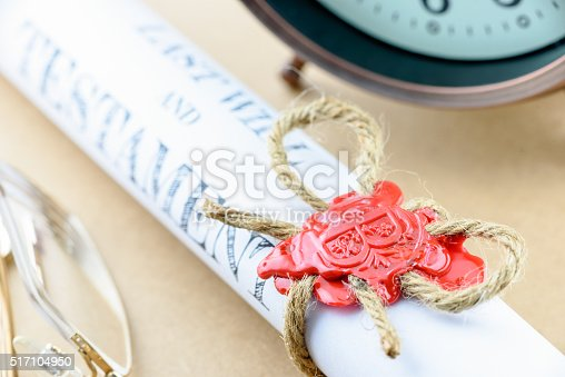584597964 istock photo Rolled up scroll of last will and testament. 517104950