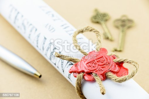 584597964 istock photo Rolled up scroll of Last will and testament 530767106