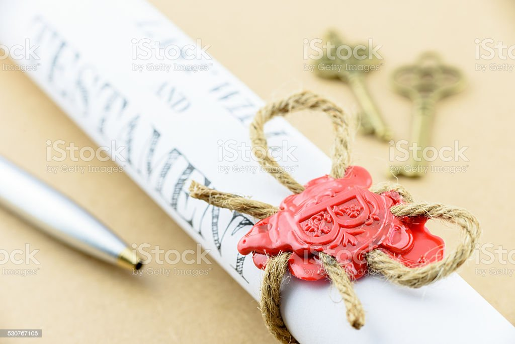 Rolled up scroll of Last will and testament stock photo