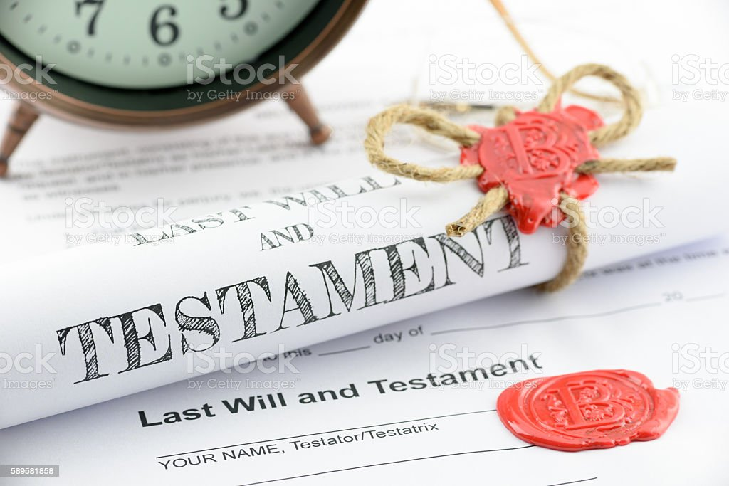 Rolled up scroll of last will and testament. stock photo