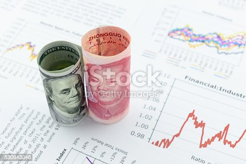 istock Rolled up scrolls of US dollar bill and Chinese Yuan 530943048