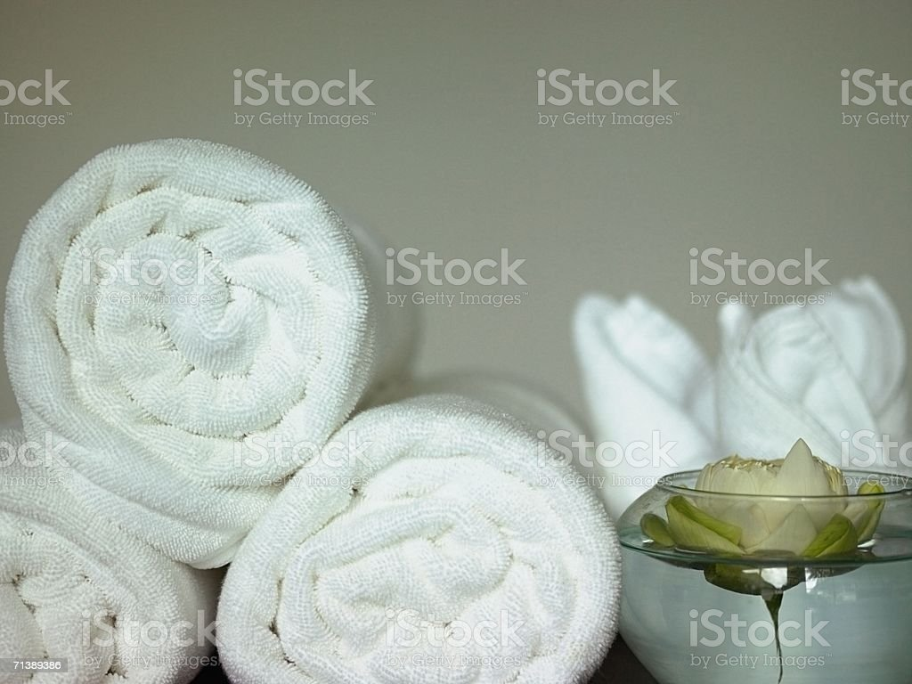Rolled up towels and a rose royalty-free stock photo