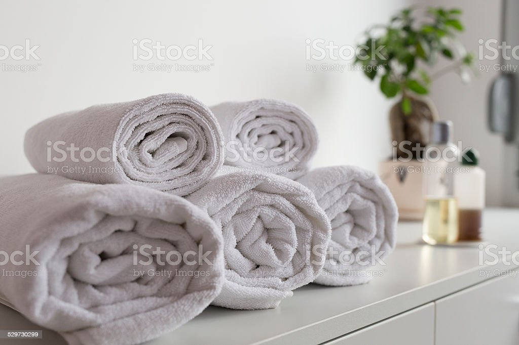 Rolled up towels and pampering products stock photo
