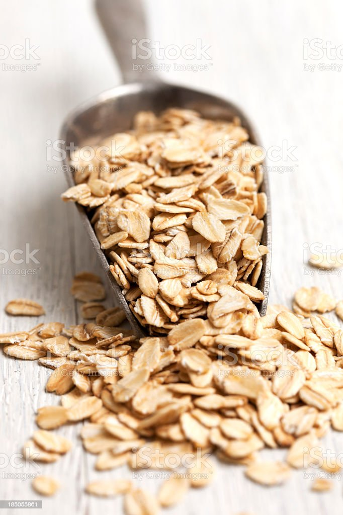 Rolled whole oats, oatmeal stock photo