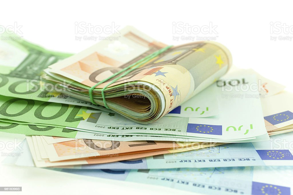 rolled with rubber euro notes on white background royalty-free stock photo