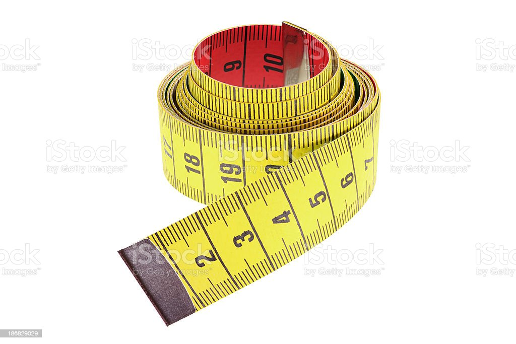 rolled yellow tape measure isolated on white royalty-free stock photo