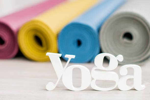 rolled yoga mats - icon set healthy foto e immagini stock