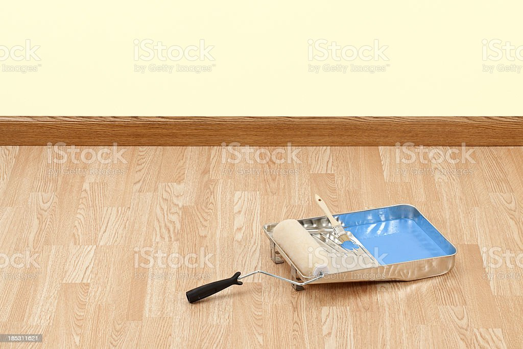 Roller and Blue Paint in Tray stock photo