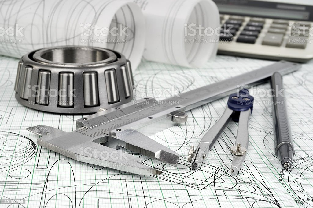 roller bearing, vernier callipers , calculator, compasses, technical pen and drawings stock photo