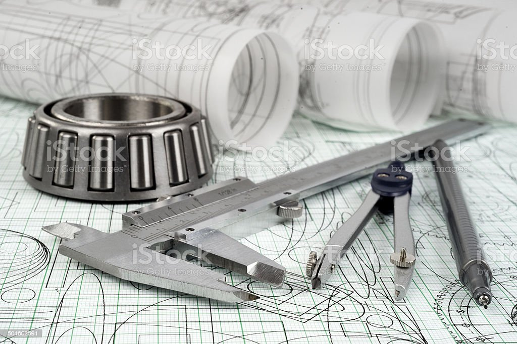 roller bearing, vernier callipers , compasses, technical pen and drawings royalty-free stock photo