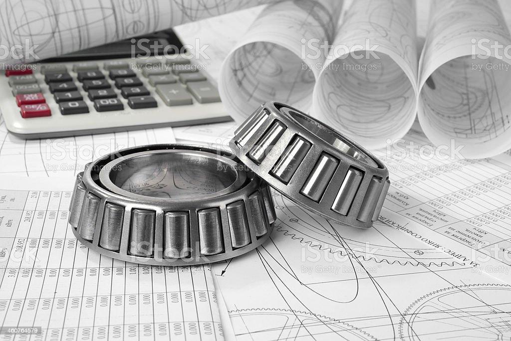 roller bearings, calculator and drawings stock photo