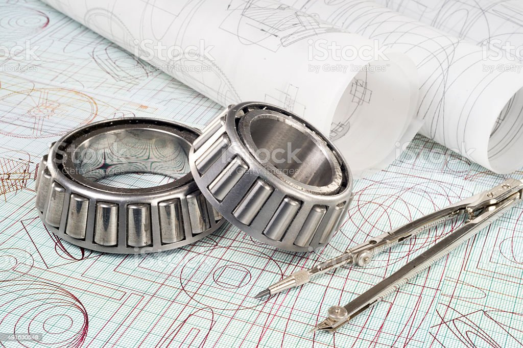 roller bearings, compasses  and drawings stock photo