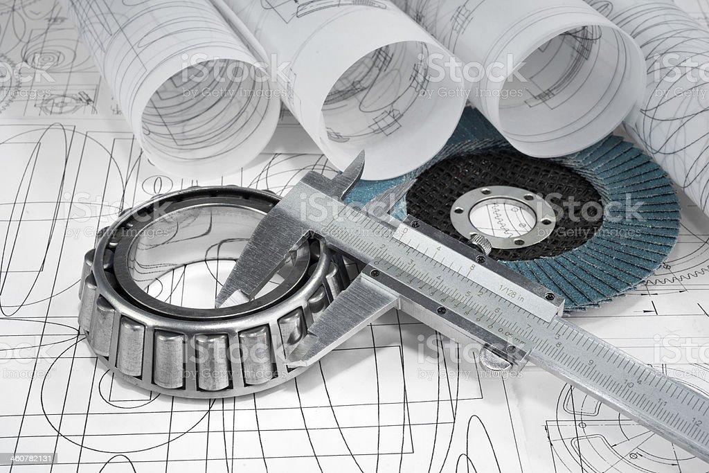 roller bearings, gauge, grinding disc  and drawings stock photo