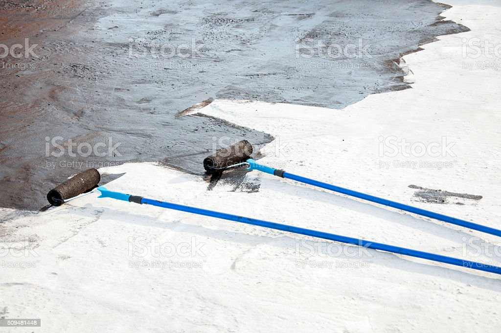roller brush, tool for waterproofing stock photo