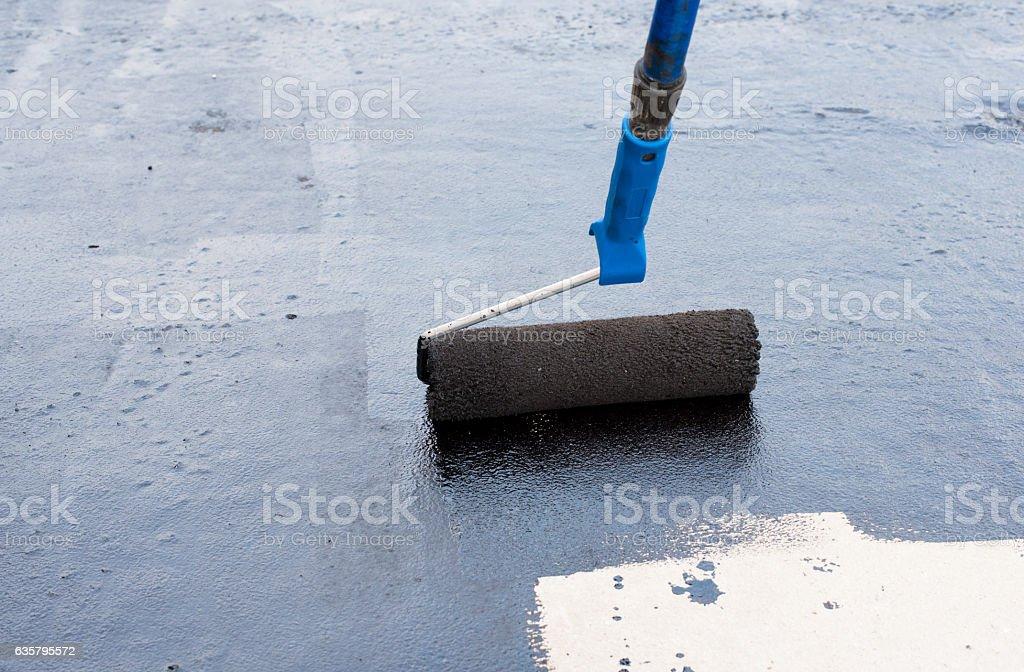Roller brush waterproofing stock photo