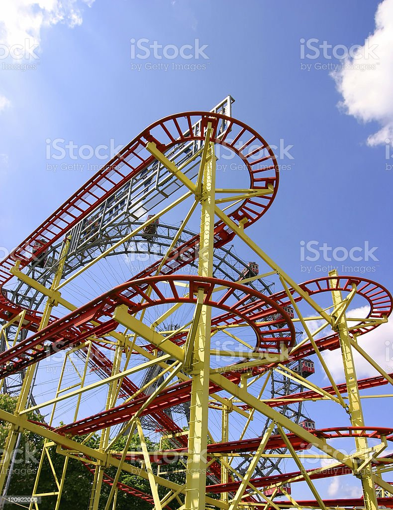 Roller coaster and large ferris wheel in Vienna royalty-free stock photo