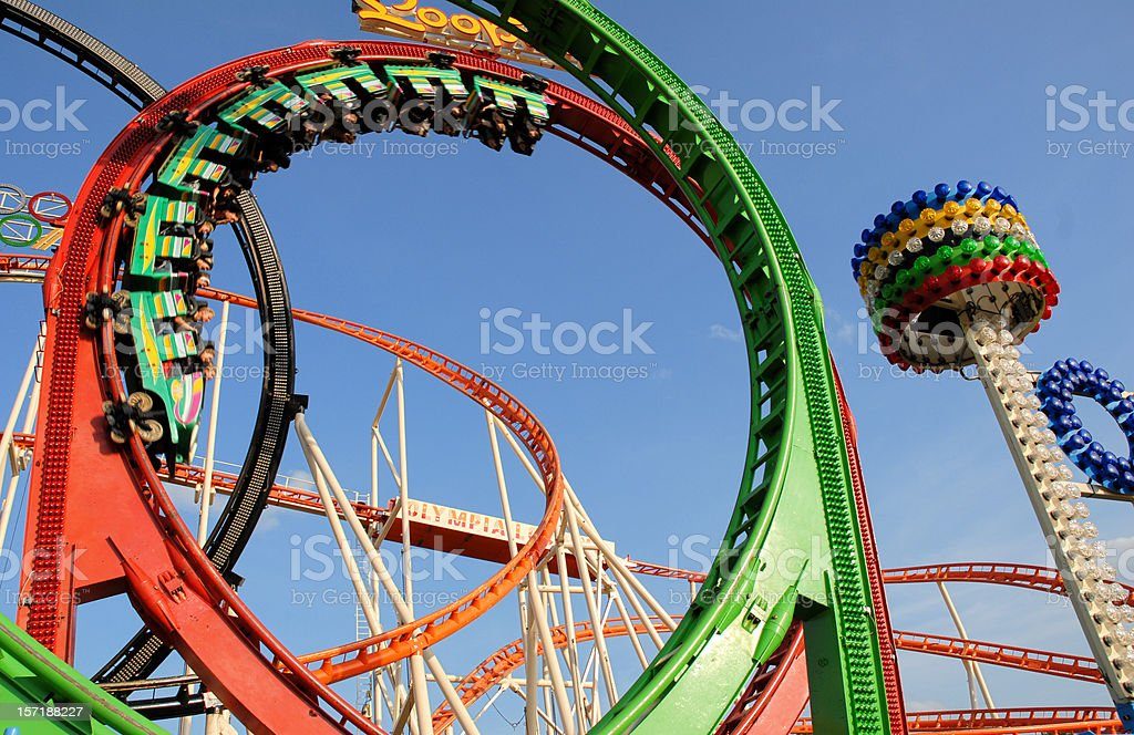 Roller coaster going around a multi-colored loop royalty-free stock photo