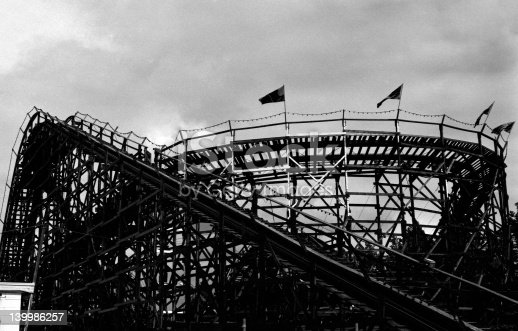 A silhouetted roller coaster, taken on high speed black and white film for dramatic effect.