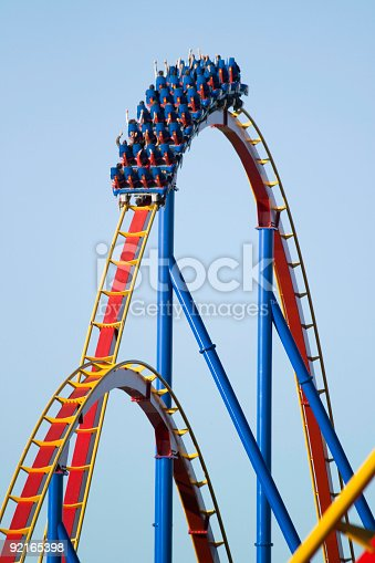 Colorful roller coaster  lit by low sunset to accentuate saturation.