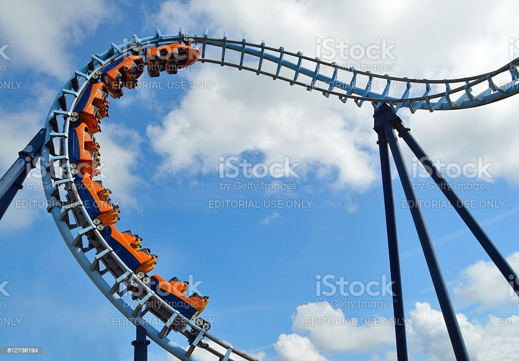 Roller coaster  ride filled  with thrill seekers stock photo