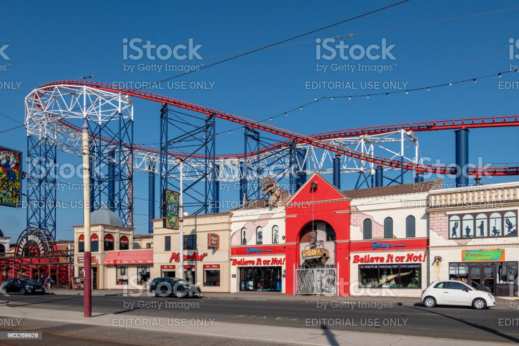 Roller Coaster track over shops at the Pleasure Beach in Blackpool stock photo