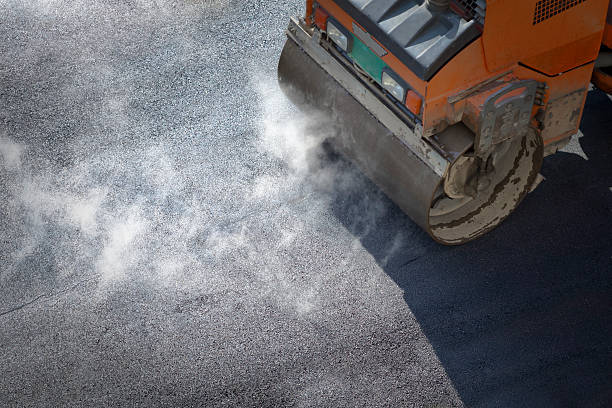 A roller compacting asphalt on a road Heavy Vibration roller compactor at asphalt pavement works for road repairing compactor stock pictures, royalty-free photos & images