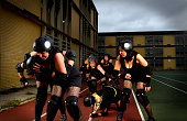 Composite of only three roller derby girls in a heated battle.