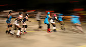 Girls on roller skates speed by