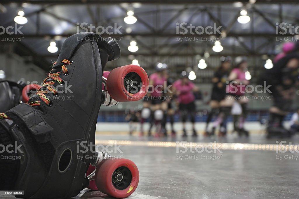 Roller derby skater fall stock photo