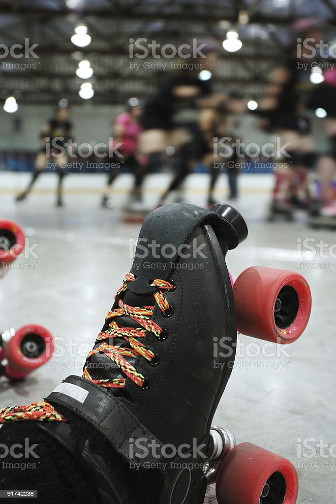 Roller derby skater knocked out stock photo