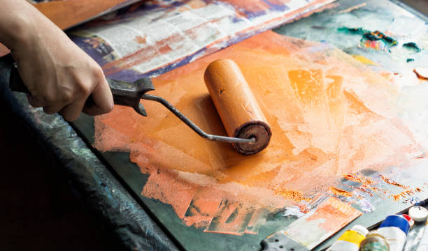Roller for applying paint on printed form stock photo
