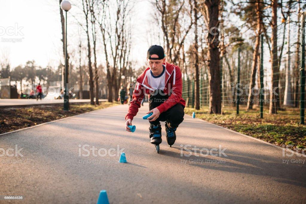 Roller skater in skates, balance exercise foto de stock libre de derechos