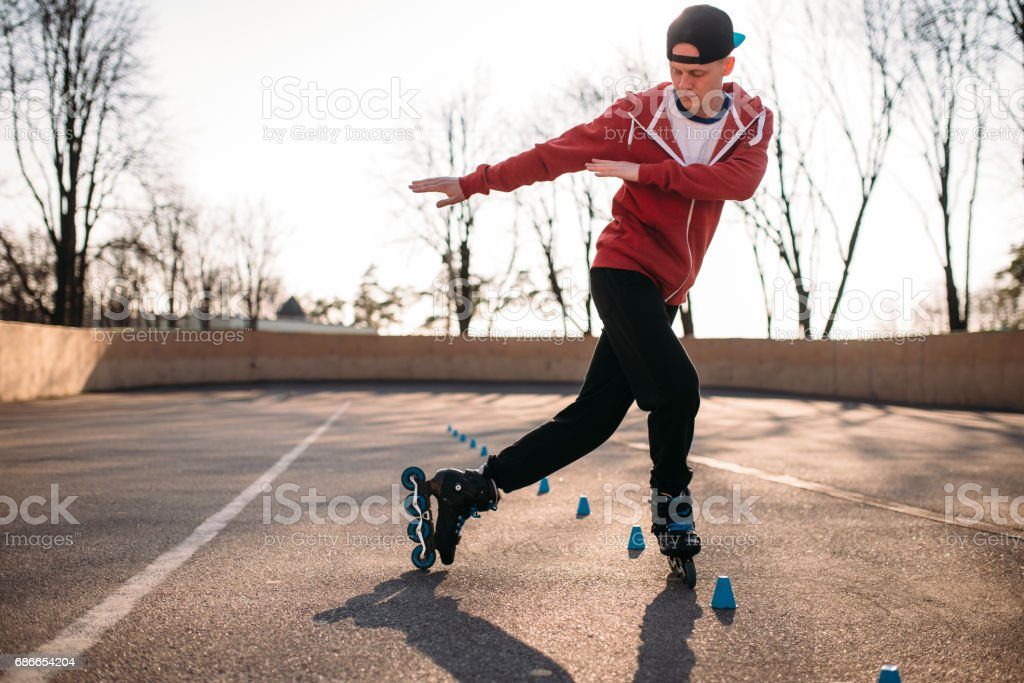 Roller skater rides the snake, speed exercise royalty-free stock photo