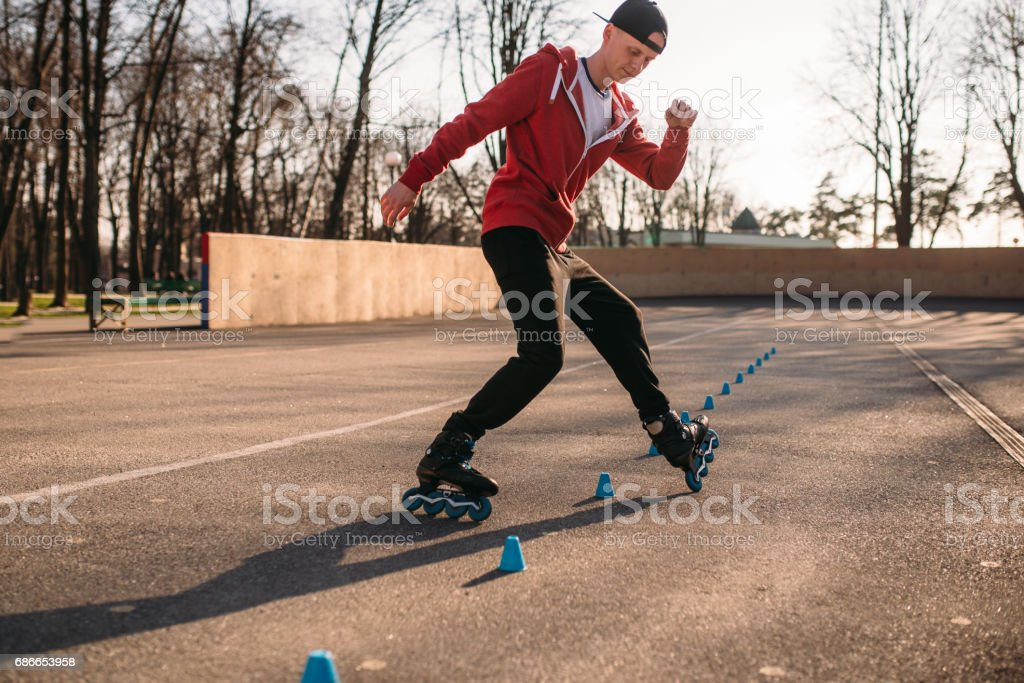Roller skater, trick exercise in park royalty-free stock photo