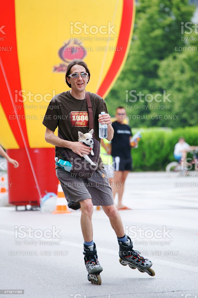Roller skater with dog and bottle of water royalty-free stock photo