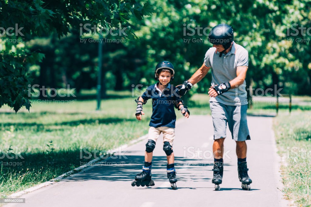 Roller skating, summer fun with grandfather stock photo