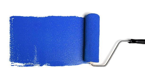 Roller With Blue Paint stock photo