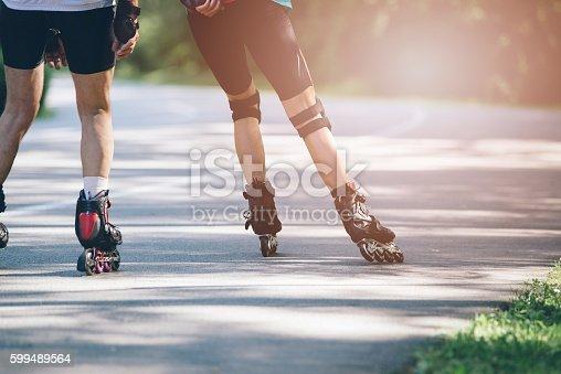 Rollerblading on asphalt road. Summer sunny day