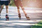 Rollerblading on asphalt road.