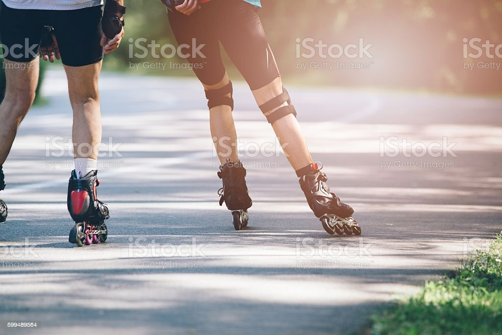 Rollerblading on asphalt road. – Foto