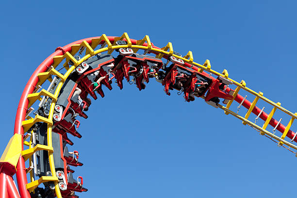rollercoaster against blue sky - roller coaster stock pictures, royalty-free photos & images