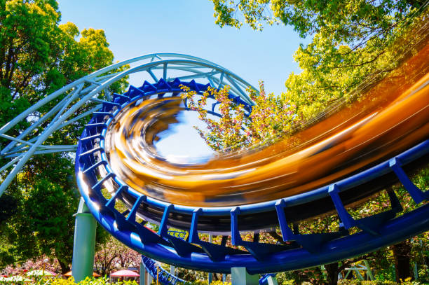Rollercoaster at amusement park Rollercoaster at amusement park amusement park stock pictures, royalty-free photos & images