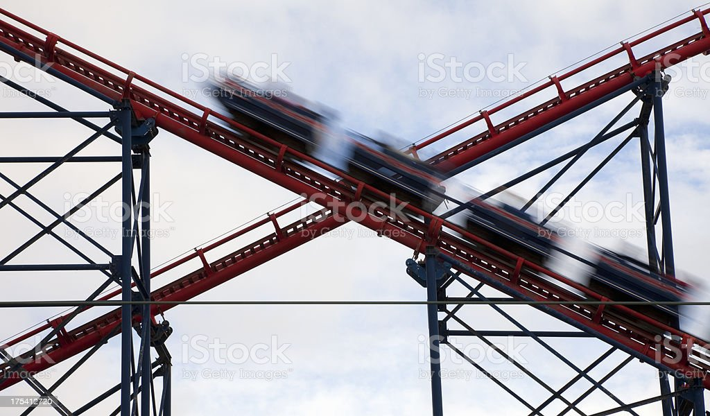 Rollercoaster high speed cars stock photo