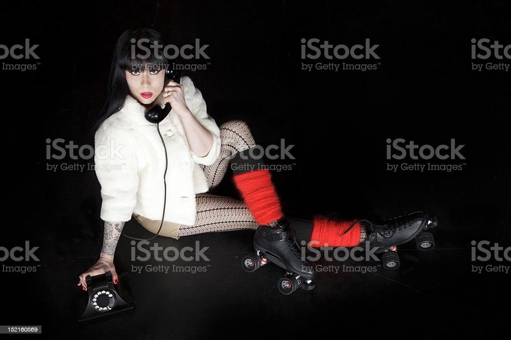 Rollergirl Posing with Vintage Phone, Pinup Style stock photo
