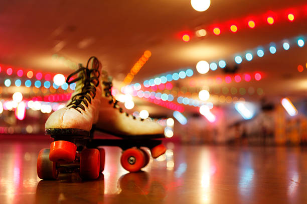 rollerskates in the roller disco - disco dancing stock photos and pictures