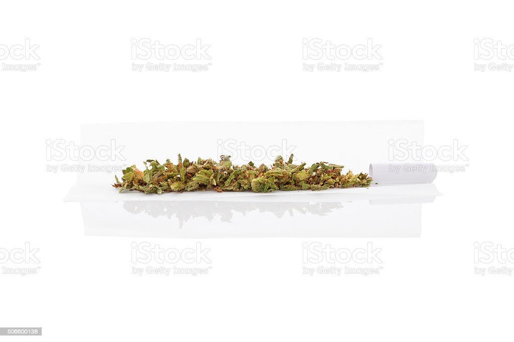 Rolling a cannabis joint. stock photo