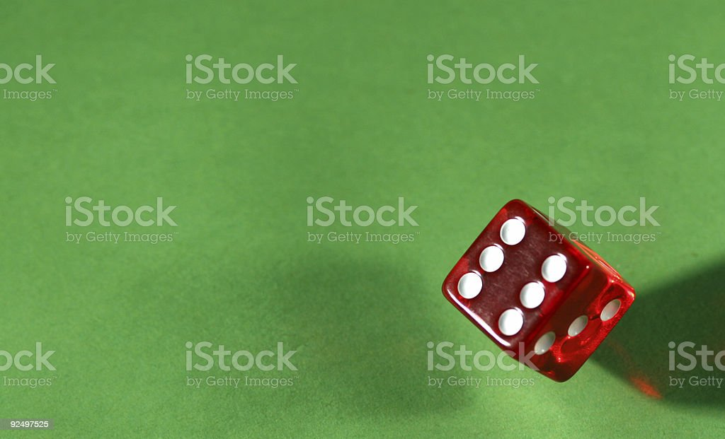 Rolling a six royalty-free stock photo